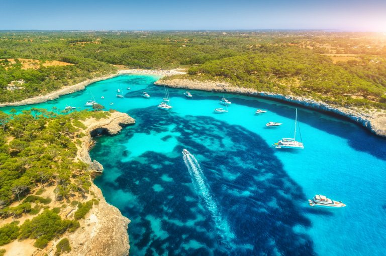 Aerial view of boats, luxury yachts and transparent sea