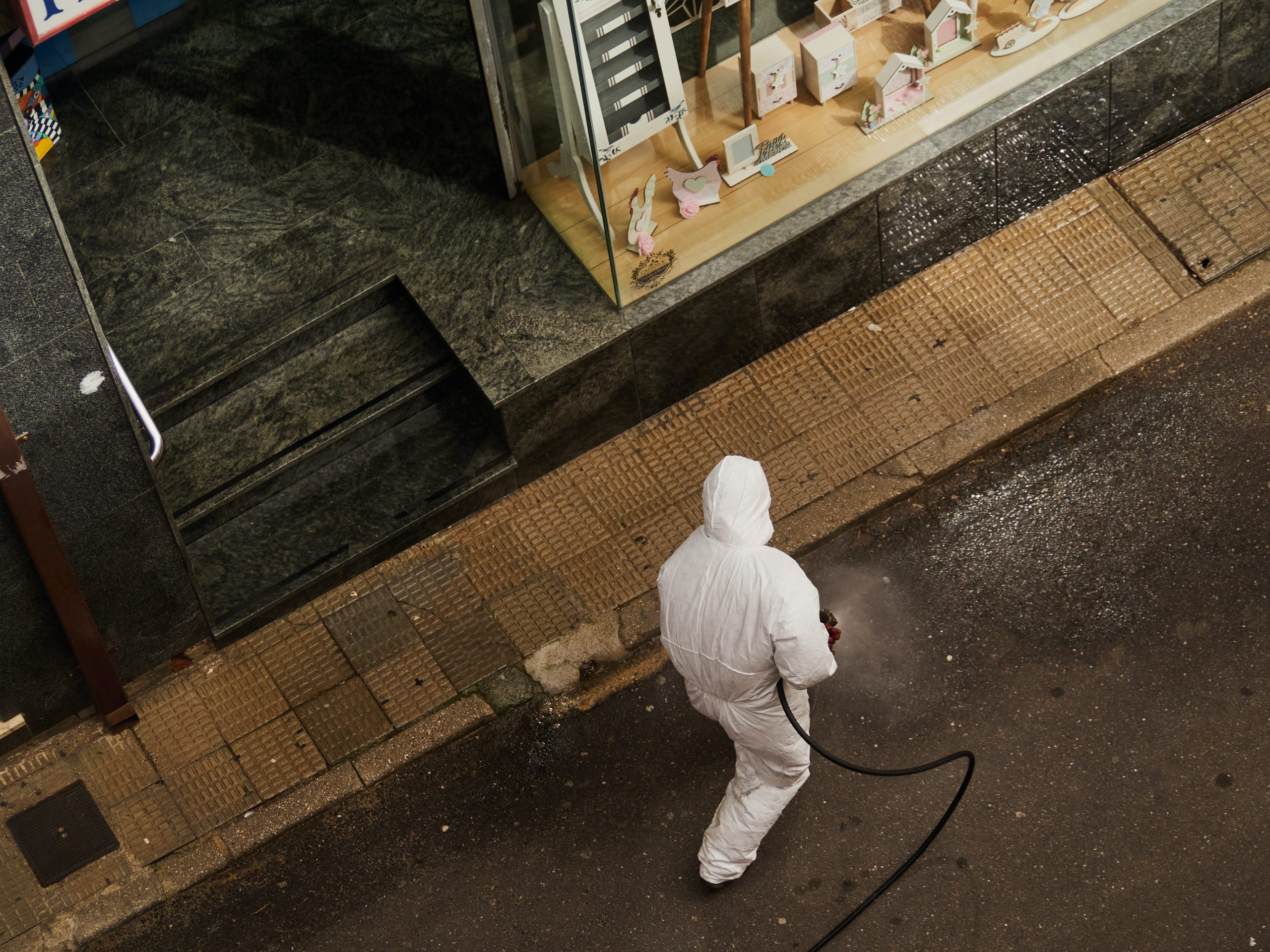 man in white thobe walking on sidewalk during daytime