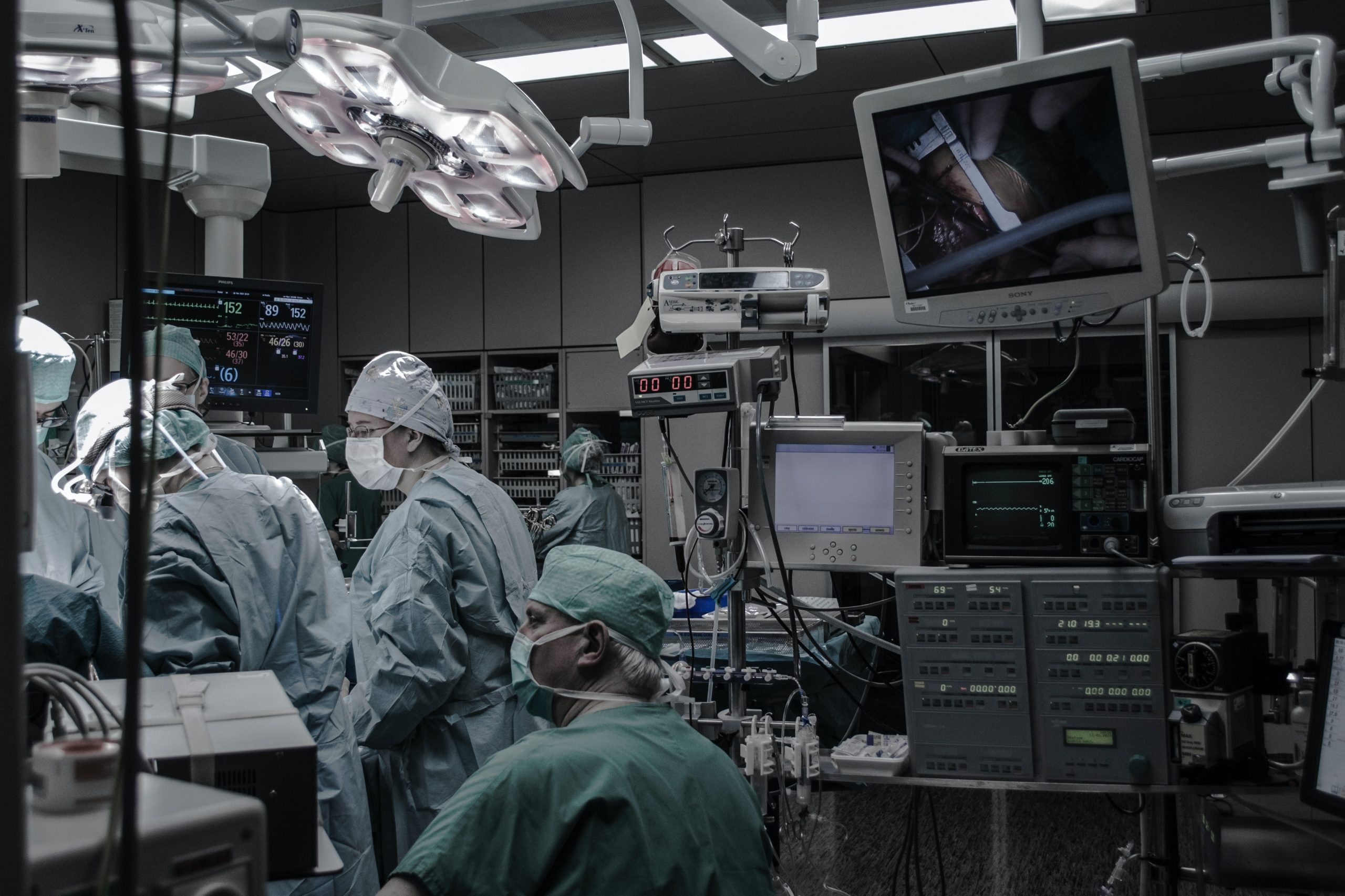 people wearing surgical clothes inside operating room