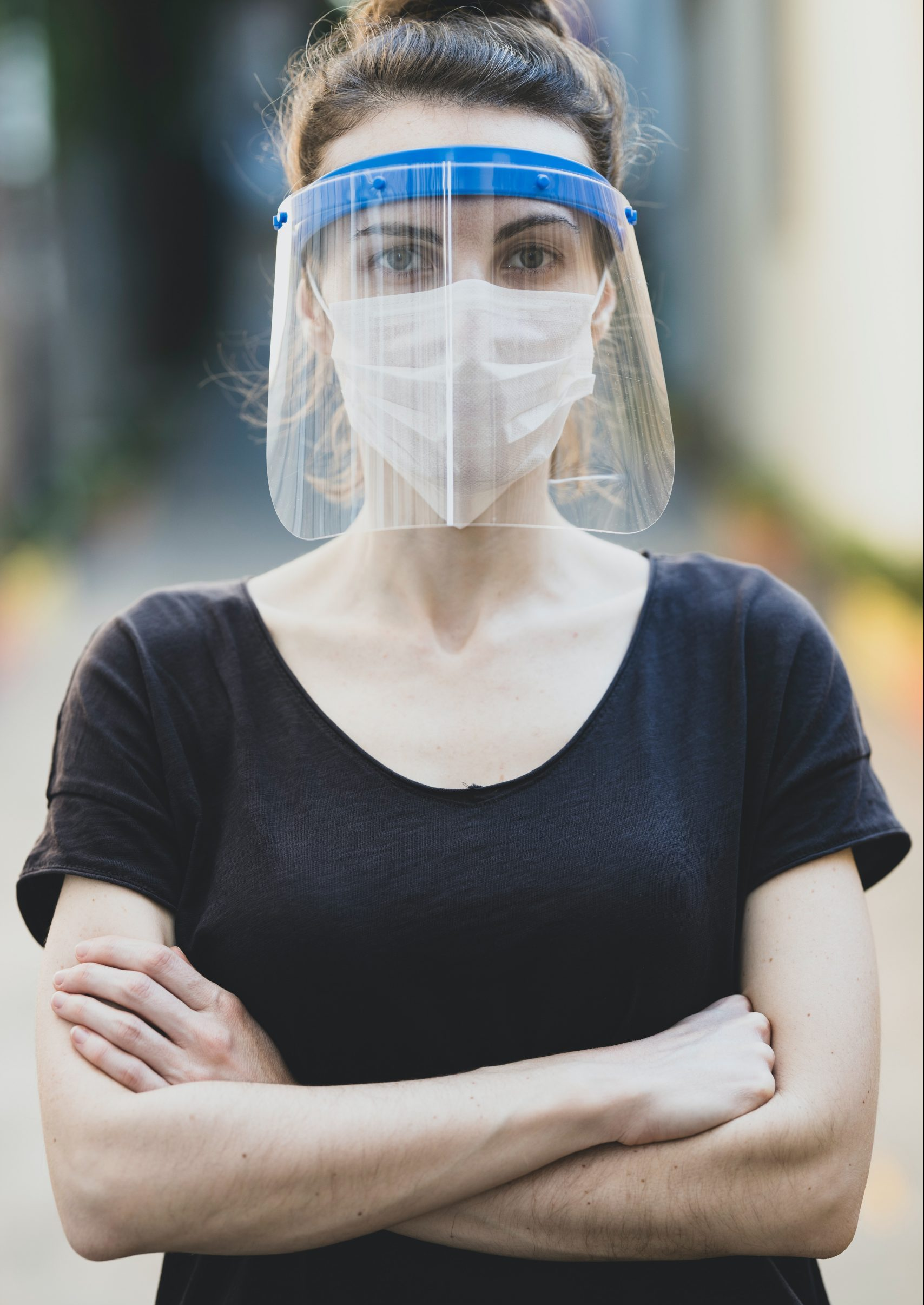 woman in black scoop neck shirt wearing white face mask