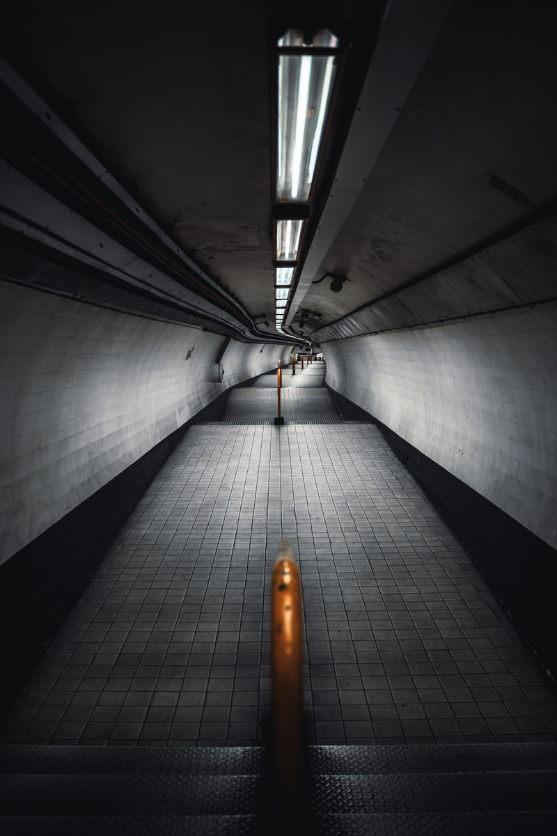 white and black tunnel with light